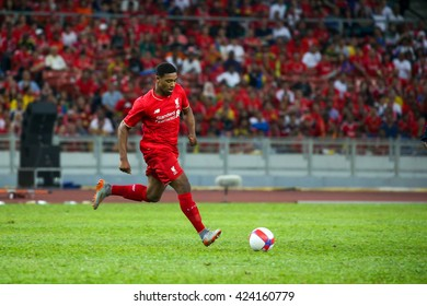 July 24, 2015- Shah Alam, Malaysia: Liverpool's Jordan Ibe dribbles the ball in a friendly match against the Malaysian team. Liverpool Football Club from England is on an Asia tour.