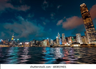 July 24, 2017 - Victoria Harbor, Hong Kong, China : View of Hong Kong Victoria Harbor on the Star Ferry at beautiful blue hour. The ferry is passing the harbor from Central to Tsim Sha Tsui.