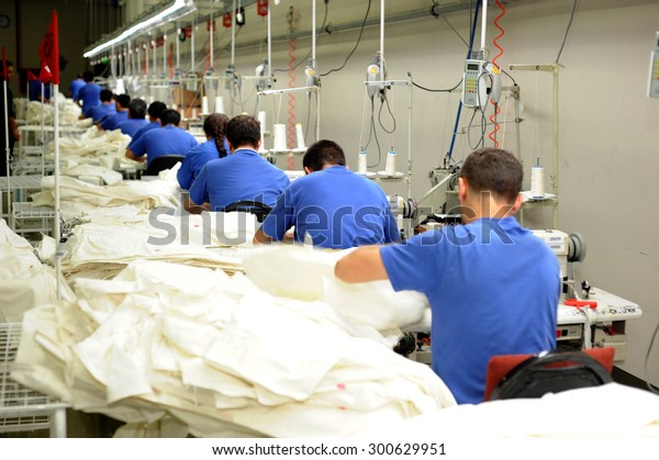 JULY 24,2014 - ISTANBUL,TURKEY. Textile is very important sector for turkish economy. At the same time this sector is generating employment. The workers are seen on the picture in a factory