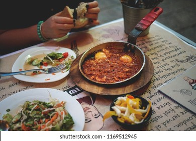 July 25, 2018.Dinner with Shakshuka and salads in a cafe of Yaffo, Tel Aviv. Horizontal photo