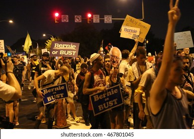 """July 26th, 2016 Philadelphia, PA: Democratic National Convention - A large group carrying """"Bernie or Bust"""" Signs chant as they take up the width of Broad St"""
