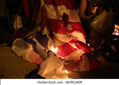 July 26th, 2016 Philadelphia, PA: Democratic National Convention - Demonstrators set an American and Israeli Flag ablaze
