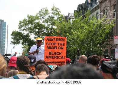 """July 26th, 2016 Philadelphia, PA: Democratic National Convention - Demonstrators preparing to march as a man holds a sign that reads """"Stop the War on Black America"""""""