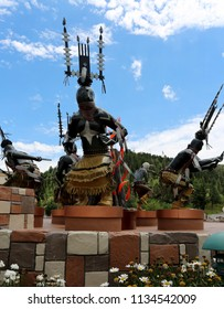 July 27, 2017. New Mexico's Inn of the Mountain Gods mountain resort, golf courses and casino. Apache Mescalero spirit dancers sculptures at entrance. HDR image.
