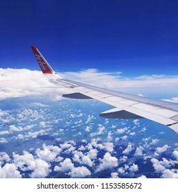 July 29, 2018 : Aerial view from window seat, Airbus A320 AirAsia. Flying above the cloud with blue sky. Take off from Kuala Lumpur.