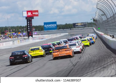 July 29, 2018 - Long Pond, Pennsylvania, USA: The Monster Energy Nascar Cup series races through turn three at the Gander Outdoors 400 at Pocono Raceway in Long Pond, Pennsylvania.