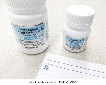 July 29, 2018-ogden Utah USA: oxycodone and methadone bottle next to prescription pad. These drugs have been leading to increase use and abuse in current culture. It is leading to an opioid crisis