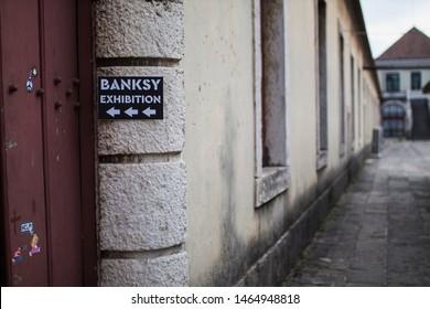 Belém/Portugal - July 29 2019: Banksy street works in an unauthorized exhibition in a museum in Belém, Lisbon.