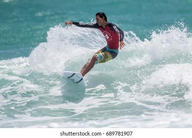 JULY 29: unidentified surfer in Kata beach surfing contest in rainy season at Kata beach Phuket on July 29-30, 2017 in Kata beach, Phuket, Thailand.