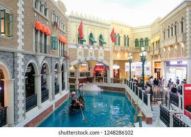 JULY 29th 2018, MACAO: Venetian hotel building and gondola boat for tourists, CHINA