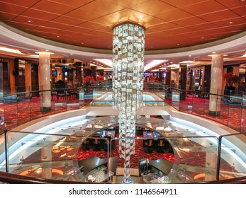 July 2nd, 2014. Mediterranean Sea, the atrium in the lobby of Norwegian Epic with a glass chandelier centerpiece.