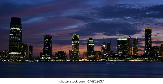 July 3, 2017; Jersey City, New Jersey, USA: The Goldman Sachs Tower and the skyline of Jersey City at sunset.