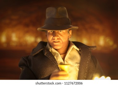 JULY 3 2018: Recreation of a scene from Indiana Jones and the Last Crusade - Doctor Jones in the Holy Grail chamber with the cup of Christ - Hasbro action figure