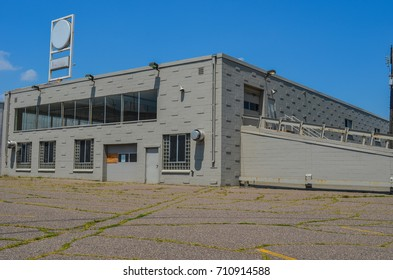JULY 30 2017 - MINNEAPOLIS, MINNESOTA: An abandoned car dealership sits empty on a sunny summer day.