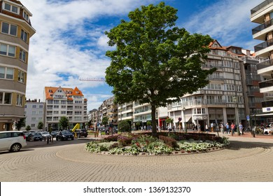 July 30, 2017. Town Knokke-Heist , Belgium, municipality in the Belgian province of West Flanders. Belgium's best-known and most affluent seaside resort .  Street of city at summer day