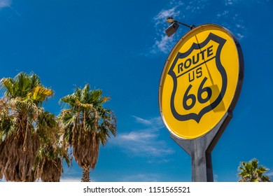 JULY 30, 2018 - SOUTHERN CALIFORNIA DESERT - USA - Yellow sign signifies Route US 66 - Nostalgia in middle of California Desert