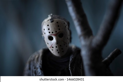 JULY 30 2019: Friday the 13th slasher Jason Voorhees lurking behind a tree in the woods - NECA Ultimate Jason action figure