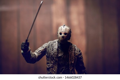 JULY 30 2019: Friday the 13th slasher Jason Voorhees with machete lurking in the woods - NECA Ultimate Jason action figure