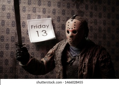 JULY 30 2019: Friday the 13th slasher Jason Voorhees with wall calendar showing the date Friday 13 - NECA Ultimate Jason action figure