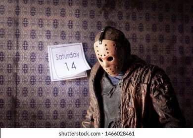 JULY 30 2019: Friday the 13th slasher Jason Voorhees looking sad with wall calendar showing the date Saturday 14 - NECA Ultimate Jason action figure