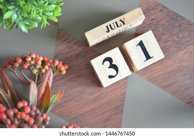 July 31. Date of July month. Diamond wood table for background.