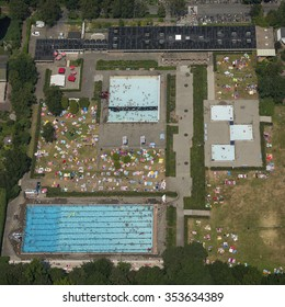 July 4, 2015, Heiloo, Holland. Aerial view of swimming pool 'Het Baafje' on a sunny day with a lot of people in the water and on the grass field.