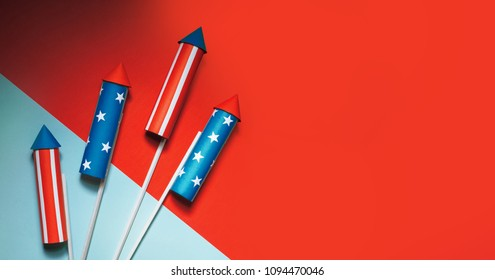 July 4, rockets for fireworks on a blue red background with space for text. in the style of minimalism