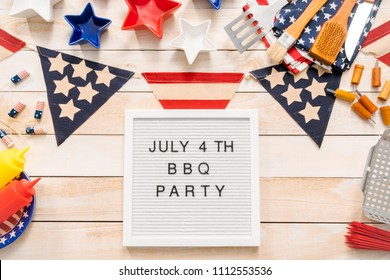 July 4th BBQ Party sign on a white mamo board.
