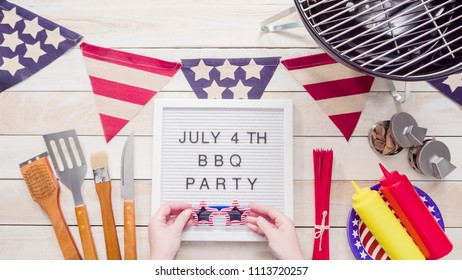 July 4th BBQ Party sign on memo board with July 4th decorations.
