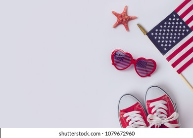 July 4th concept, Independence day celebration with USA flag, sunglasses and sneakers. View from above. Flat lay