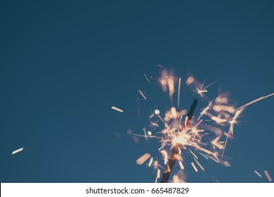 July 4th Sparklers against blue sky in Florida - top right space