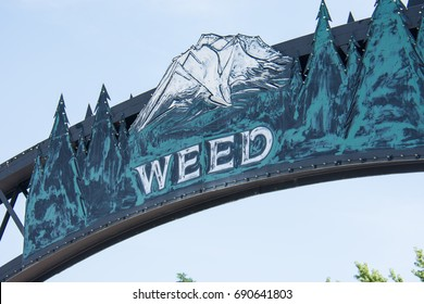 JULY 5 2015 - WEED, CALIFORNIA: Close up of the Weed arch, welcomes visitors to town. The town is named after the founder of the lumber mill and pioneer Abner Weed, not marijuana.