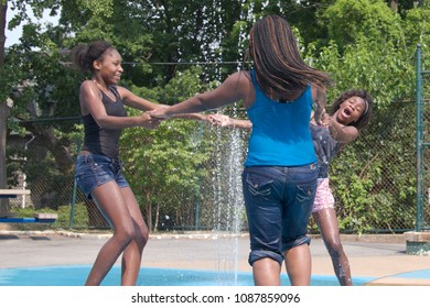 July 7, 2012 - Philadelphia, PA, USA:  African American teenagers cool off in one of the city's public spray grounds on a hot summer day in Philadelphia, Pennsylvania.