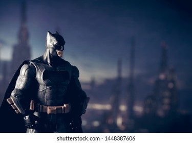 JULY 7 2019: Batman DC Comics action figure standing in front of a Gotham City backdrop at night
