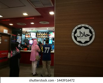 """July 7, 2019 - McDonald's Shah Alam, Malaysia. A logo of approved Islamic certified food at local food restaurant in Malaysia for customers reference. Translation """"Halal"""" : Islamic certified Malaysia"""