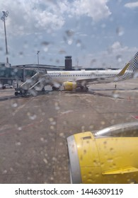 July 7th, 2019. Vueling Airbus 320 seen through an airplane window in a rainy day in Barcelona - El Prat airport.