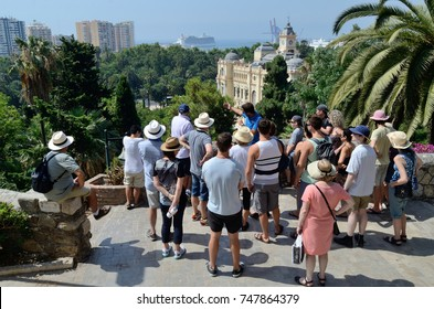 July 8, 2015, Malaga, Spain.   A Tour Group Listens To A Tour Guide As They Look Over The Harbor At Malaga, Spain
