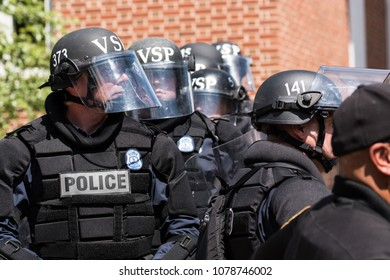 July 8, 2017 Charlottesville, Virginia USA  Virginia State Police riot squad being dispersed into crowd at KKK rally supporting Stonewall Jackson confederate statue in Justice Park