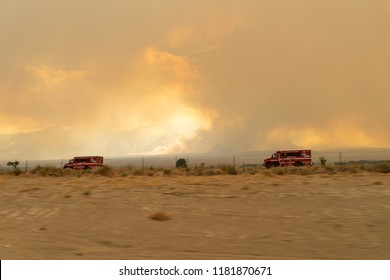 JULY 8 2018 - LONE PINE, CALIFORNIA: CalFire fire trucks rush to the scene of the Georges Fire, a wildfire spreading in the Eastern Sierra Nevada mountains in California