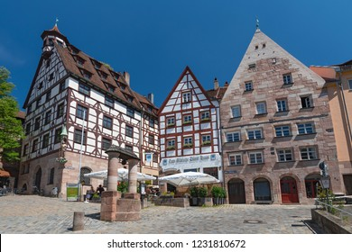 July 8, 2018. Old city and the square Tiergaertnertorplatz with the house Pilatushaus and the restaurant Albrecht Duerer Haus, Middle Franconia, Bavaria, Nuremberg, Germany.