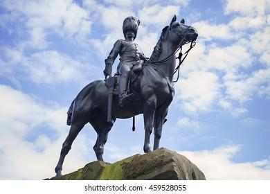 JULY 9, 2016 - EDINBURGH, SCOTLAND Looking up at the Royal Scots Grey statue on Princes Street in Edinburgh, Scotland.