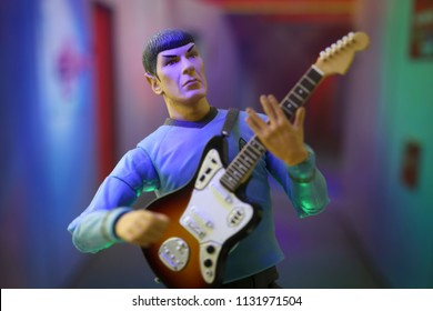 JULY 9 2018: Scene from Star Trek the Original Series - Rock Out with your Spock Out concept - Mr Spock with an electric guitar in an Enterprise corridor - Art Asylum action figure