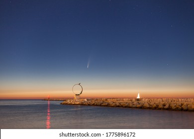 July, 9, 2020: C/2020 F3 Neowise comet over the pier of San Benedetto del Tronto , a touristic city on the Adriatic coast
