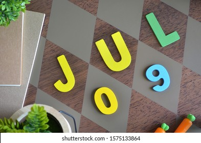 July 9, Appointment with wooden text design for background.