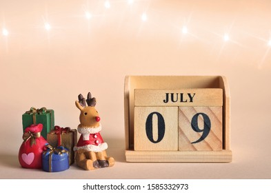July 9, Christmas, Birthday with number cube design for background.