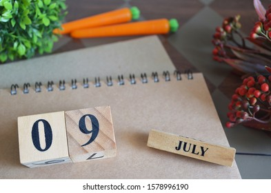 July 9, Save the date with number cube design for background.
