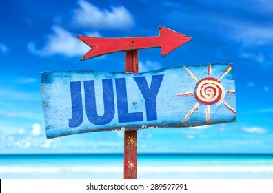 July sign with beach background
