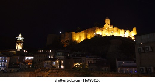 Jumah Mosque and Fortress Narikala During the Night with Visible Moon Taken from Bottom, Tbilisi, Georgia