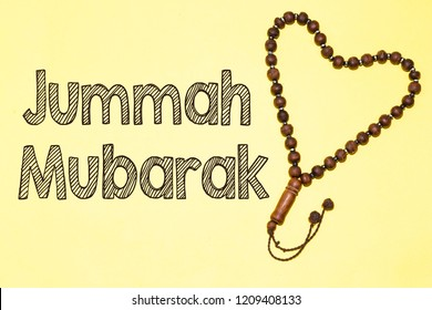 Jumah Mubarakah (=Friday Mubarak) and  heart shape forming with tasbih
