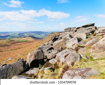 A jumble of gritstone rocks cover the slopes of Higger Tor in the Derbyshire Peak District.